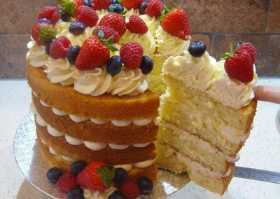"Naked Birthday Cake with Fresh Fruit - 6"" - (approx 15 servings) - £50.00 - 8"" - (approx. 25 servings) - £60.00 - 10"" - (approx. 35 servings) - £70.00"