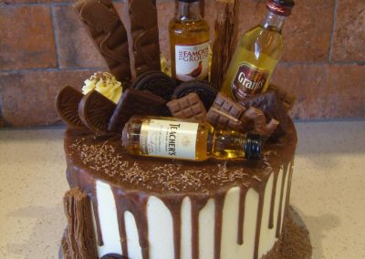 "Whiskey - Chocolate Drip - 6"" (approx 15 servings) - £50.00, 8"" (approx. 25 servings) - £60.00,  10"" - (approx. 35 servings) - £70.00 - 3 miniature bottles of Whiskey £7.00 extra"