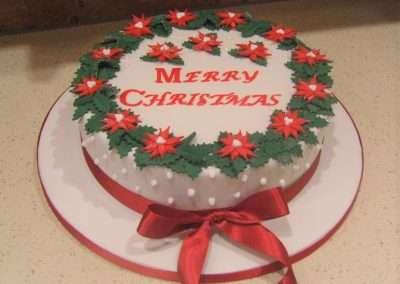 """Merry Christmas Poinsettia - (Fruit or Sponge) - 6"""" (approx 15 servings) - £50.00, 8"""" (approx. 25 servings) - £60.00,  10"""" - (approx. 35 servings) - £70.00"""