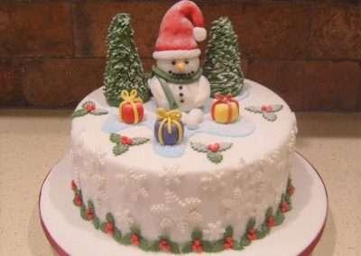 """Frosty The Snowman - (Fruit or Sponge) - 6"""" (approx 15 servings) - £50.00, 8"""" (approx. 25 servings) - £60.00,  10"""" - (approx. 35 servings) - £70.00"""